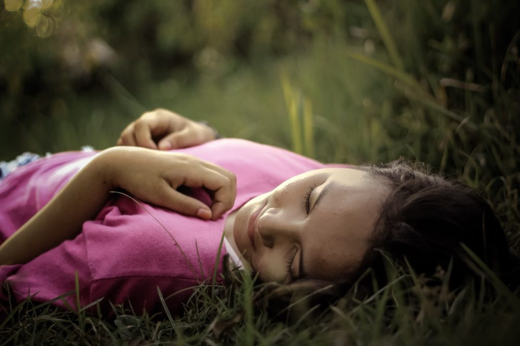Self Care Blog: Woman resting in field